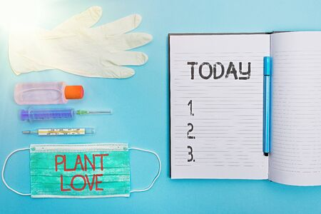 Handwriting text writing Plant Love. Conceptual photo a symbol of emotional love, care and support showed to others Set of medical equipment with notepad for health condition assessment