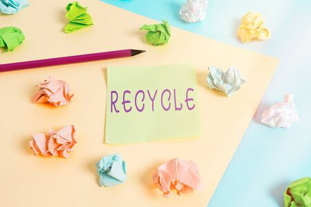 Word writing text Recycle. Business photo showcasing process of converting waste materials into new materials and objects Colored crumpled papers empty reminder blue yellow background clothespin 스톡 콘텐츠