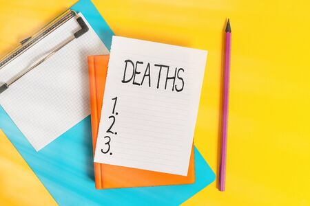 Handwriting text writing Deaths. Conceptual photo permanent cessation of all vital signs, instance of dying individual Pile of empty papers with copy space on the table
