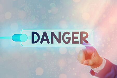 Conceptual hand writing showing Danger. Concept meaning general word for liability to all kind of injury or evil consequences Graphics padlock for web data security application system Stock Photo