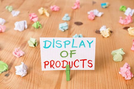 Conceptual hand writing showing Display Of Products. Concept meaning advertise nature business presentation to attract consumers Colored crumpled papers wooden floor background clothespin