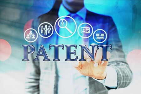 Handwriting text writing Patent. Conceptual photo intellectualproperty that gives owner legal right has the sole right Information digital technology network connection infographic elements icon Foto de archivo