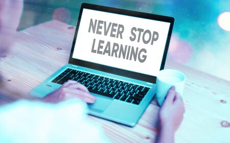 Conceptual hand writing showing Never Stop Learning. Concept meaning continuous education and techniques to be competitive Modern gadgets white screen under colorful bokeh background