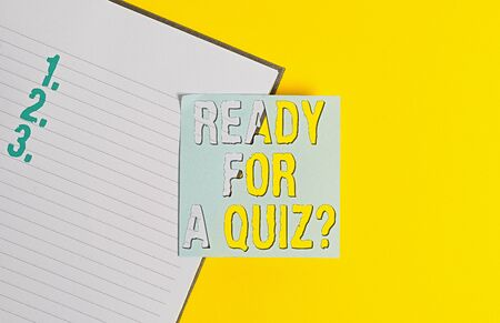 Conceptual hand writing showing Ready For A Quiz Question. Concept meaning Taking educational assessment Preparing an exam Paper with copy space on yellow table. Paper for text messages