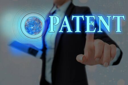 Word writing text Patent. Business photo showcasing intellectual property that gives owner legal right has the sole right Futuristic icons solar system. Foto de archivo - 150266567