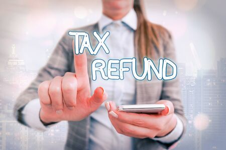 Handwriting text writing Tax Refund. Conceptual photo excess payment of paid taxes returned to business owners Touching screen digital application marking important details in business