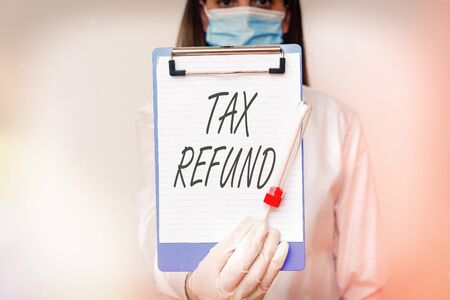 Handwriting text Tax Refund. Conceptual photo excess payment of paid taxes returned to business owners Laboratory blood test sample shown for medical diagnostic analysis result Foto de archivo