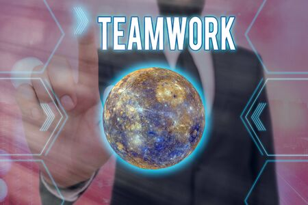 Handwriting text writing Teamwork. Conceptual photo the group s is collaborative effort to accomplish a common goal Futuristic icons solar system. Stock Photo