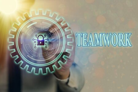 Writing note showing Teamwork. Business concept for the group s is collaborative effort to accomplish a common goal Graphics padlock for web data information security application system Foto de archivo