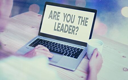 Conceptual hand writing showing Are You The Leader Question. Concept meaning asking for the qualification of being a good boss Modern gadgets white screen under colorful bokeh background