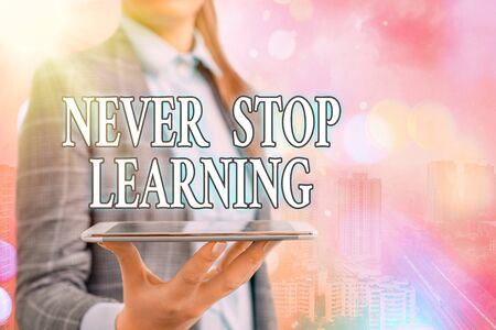 Conceptual hand writing showing Never Stop Learning. Concept meaning continuous education and techniques to be competitive Touch screen digital marking important details in business Standard-Bild