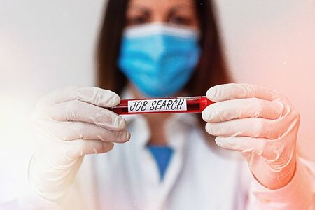 Writing note showing Job Search. Business concept for an act of sourcing for job openings and apply for a position Laboratory blood test sample for medical diagnostic analysis Standard-Bild