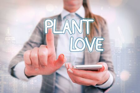 Handwriting text writing Plant Love. Conceptual photo a symbol of emotional love, care and support showed to others Touching screen digital application marking important details in business