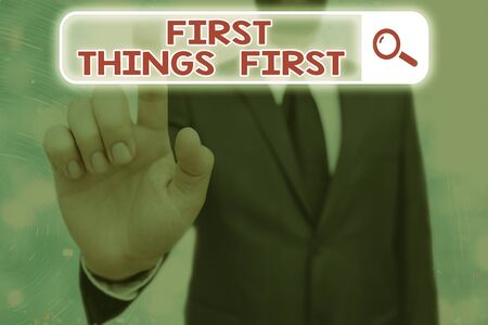 Conceptual hand writing showing First Things First. Concept meaning Business, technology, internet, set your priorities and most important Web search digital futuristic technology network connection