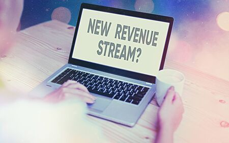 Conceptual hand writing showing New Revenue Stream Question. Concept meaning Additional Enhanced Source of Income Improved Approach Modern gadgets white screen under colorful bokeh background Stock Photo