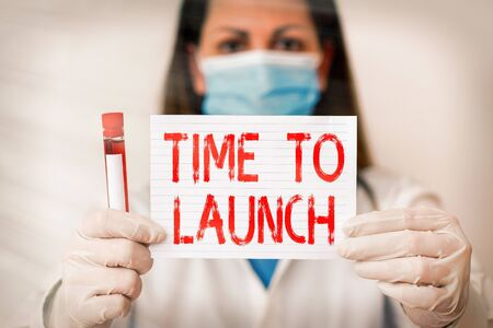 Conceptual hand writing showing Time To Launch. Concept meaning Business StartUp, planning and strategy, management, realization Laboratory blood test sample for medical diagnostic analysis