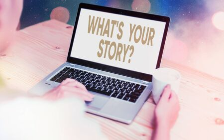 Conceptual hand writing showing What S Your Story Question. Concept meaning Share or tell us your life experiences and success Modern gadgets white screen under colorful bokeh background Stock Photo