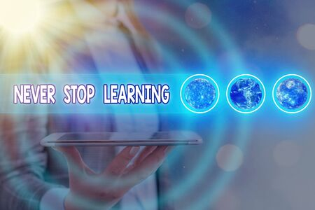 Word writing text Never Stop Learning. Business photo showcasing continuous education and techniques to be competitive Futuristic icons solar system. Stok Fotoğraf