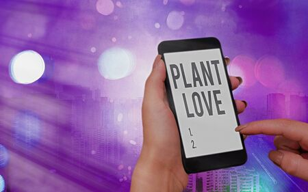 Word writing text Plant Love. Business photo showcasing a symbol of emotional love, care and support showed to others Modern gadgets with white display screen under colorful bokeh background