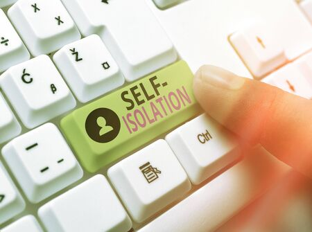 Word writing text Self Isolation. Business photo showcasing promoting infection control by avoiding contact with the public White pc keyboard with empty note paper above white key copy space Standard-Bild