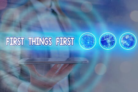 Word writing text First Things First. Business photo showcasing Business, technology, internet, set your priorities and most important Futuristic icons solar system. Zdjęcie Seryjne