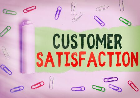 Text sign showing Customer Satisfaction. Business photo showcasing number of users whose experience ratings exceed goals Rolled ripped torn cardboard placed above a wooden classic table backdrop