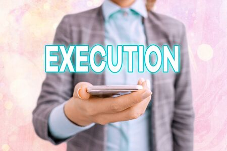 Conceptual hand writing showing Execution. Concept meaning it executes or imposes a program order or course of action Touch screen digital marking important details in business Zdjęcie Seryjne