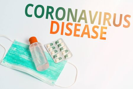 Handwriting text Coronavirus Disease. Conceptual photo defined as illness caused by a novel virus SARSCoV2 Primary medical precautionary equipments for health care protection