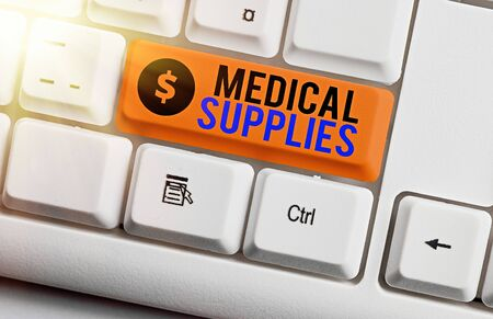 Text sign showing Medical Supplies. Business photo showcasing Items necessary for treatment of illness or injury White pc keyboard with empty note paper above white key copy space 免版税图像 - 150253046