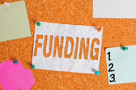 Text sign showing Funding. Business photo text act of providing resources to finance a need, program, or project Corkboard color size paper pin thumbtack tack sheet billboard notice board Zdjęcie Seryjne
