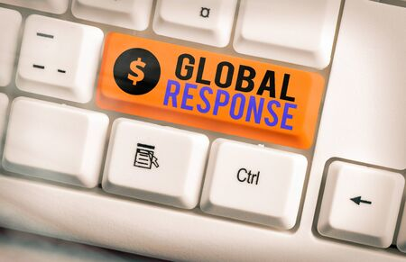 Text sign showing Global Response. Business photo showcasing indicates the behaviour of material away from impact point White pc keyboard with empty note paper above white key copy space