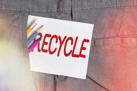 Word writing text Recycle. Business photo showcasing process of converting waste materials into new materials and objects Writing equipment and white note paper inside pocket of man work trousers