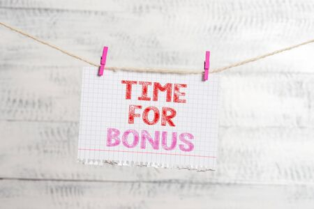 Writing note showing Time For Bonus. Business concept for Limited exclusive offer, extra discounts, crazy deal Clothesline clothespin rectangle shaped paper reminder white wood desk