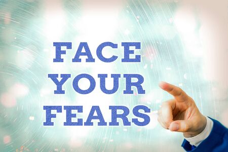 Writing note showing Face Your Fears. Business concept for Strong and confident to look into the future to success