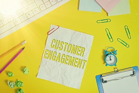 Word writing text Customer Engagement. Business photo showcasing communication connection between a consumer and a brand Flat lay above copy space on the white crumpled paper