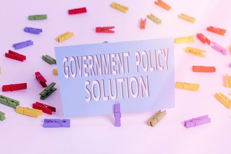 Text sign showing Government Policy Solution. Business photo text designed game plan created in response to emergency disaster Colored clothespin papers empty reminder white floor background office