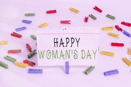 Writing note showing Happy Woman S Day. Business concept for to commemorate the essence of every lady around the world Colored clothespin papers empty reminder white floor background office