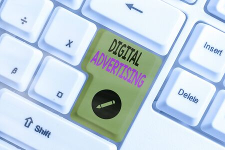 Conceptual hand writing showing Digital Advertising. Concept meaning when business leverage Internet technologies to promote White pc keyboard with empty note paper above white key copy space