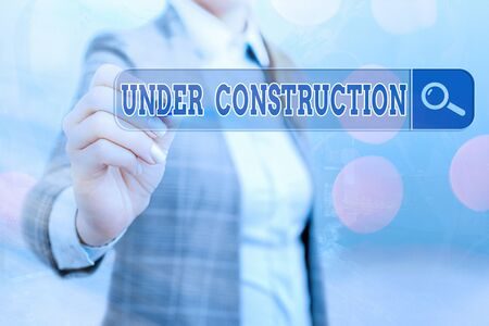 Writing note showing Under Construction. Business concept for building that is unfinished but actively being worked on Web search digital information futuristic technology network connection