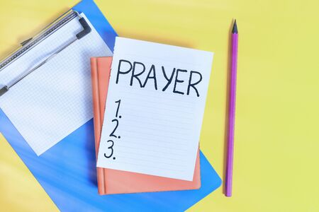 Handwriting text writing Prayer. Conceptual photo solemn request for help or expression of thanks addressed to God Pile of empty papers with copy space on the table Stock Photo
