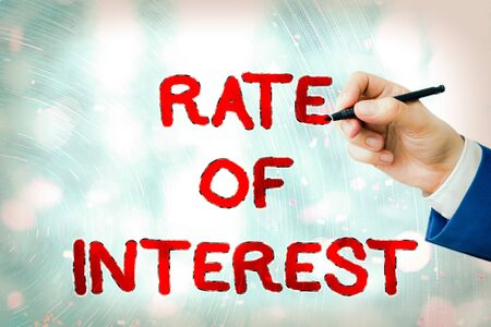 Conceptual hand writing showing Rate Of Interest. Concept meaning Percentage computed from principal amount of loan, mortgage, or investment
