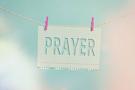 Text sign showing Prayer. Business photo text solemn request for help or expression of thanks addressed to God Clothesline clothespin rectangle shaped paper reminder white wood desk
