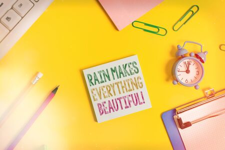 Conceptual hand writing showing Rain Makes Everything Beautiful. Concept meaning raining creates earth a wonderful place Flat lay above copy space on the white crumpled paper