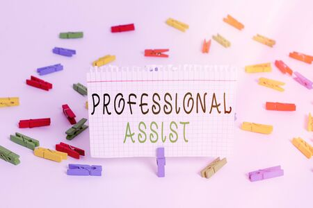 Writing note showing Professional Assist. Business concept for offer services in rehabilitation of health care licenses Colored clothespin papers empty reminder white floor background office
