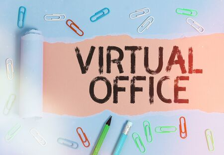 Conceptual hand writing showing Virtual Office. Concept meaning operational domain of any business or organization virtually Rolled ripped torn cardboard above a wooden classic table