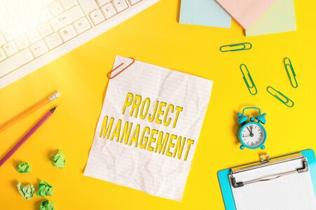 Word writing text Project Management. Business photo showcasing practice of the work of a team to achieve specific goals Flat lay above copy space on the white crumpled paper
