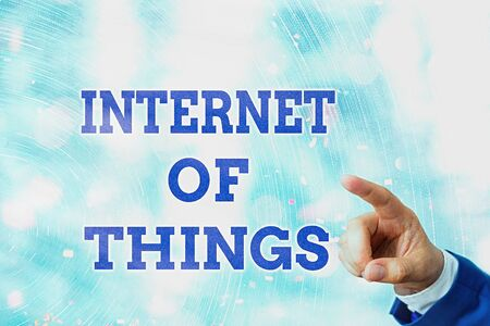 Writing note showing Internet Of Things. Business concept for network connections innovative manufacturing and smart industry