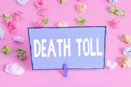 Writing note showing Death Toll. Business concept for the number of deaths resulting from a particular incident Colored crumpled papers empty reminder pink floor background clothespin