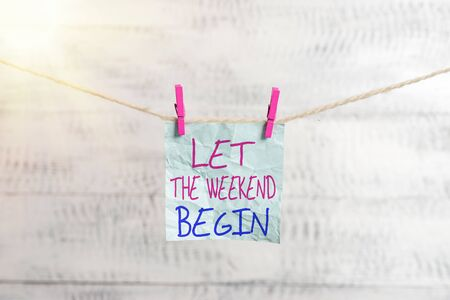 Writing note showing Let The Weekend Begin. Business concept for happy Saturday Welcome Holiday Lets enjoy the day Clothesline clothespin rectangle shaped paper reminder white wood desk