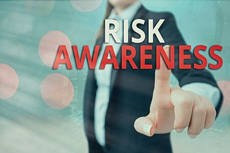 Writing note showing Risk Awareness. Business concept for recognizing factors that may cause a lifethreatening effect Touch screen digital marking important details in business
